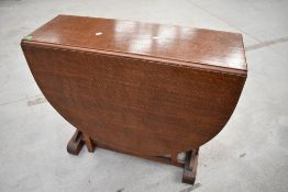 An early to mid 20th Century oak gateleg table