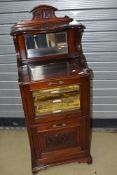 A Victorian mahogany music cabinet, with mirror back , lined and labelled shelves