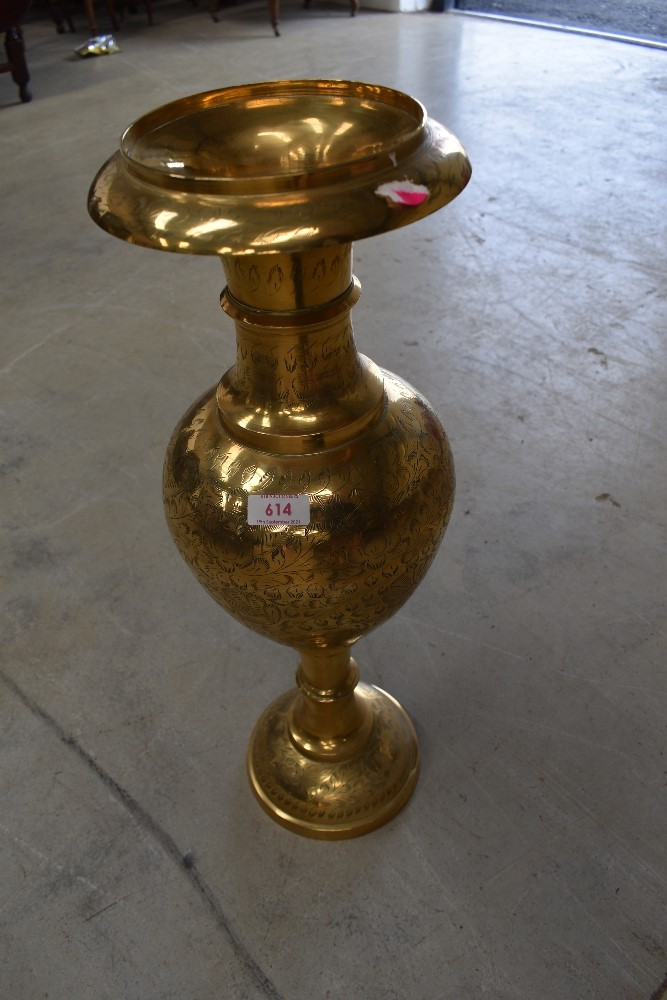 A vintage brass Eastern style vase, height approx. 60cm