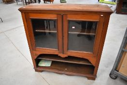 A 19th Century mahogany bookcase , glazed section over two open shelves , possibly on later base,