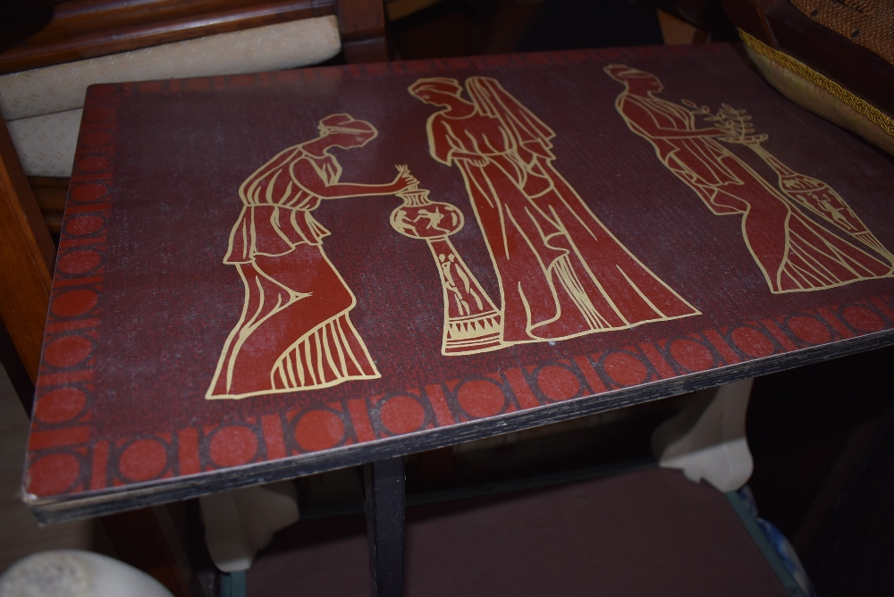 A vintage coffee table in the Piper style, having Greco-Romanesque decoration, approx. 115 x 38cm