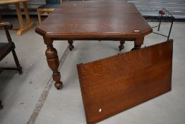 A 19th Century oak windout dining table, having canted top on turned legs, width approx 105cm,