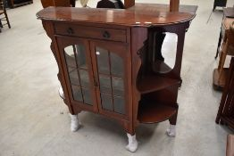 A late Victorian Dresser base having velvet and mirror back with glazed cupboard under