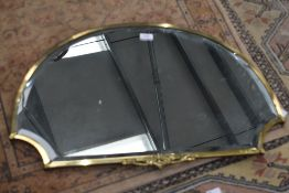 An early 20th Century brass framed wall mirror, width approx. 70cm