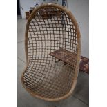 A vintage wicker hanging seat (seat and hooks only)