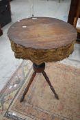A 19th Century gipsy table having turned mahogany legs, diameter approx. 46cm