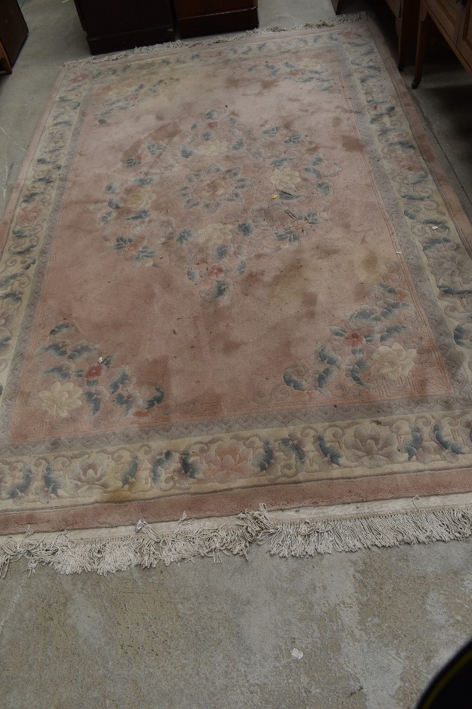 A modern Chinese carpet square having pink ground, approx. 270 x 180cm