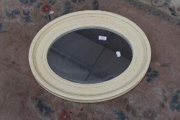 A modern oval wall mirror , approx. 54 x 44cm