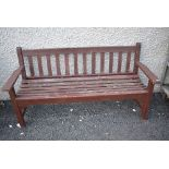 A stained frame garden bench, wood still looks sturdy enough