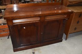 A Victorian mahogany chiffoneir/sideboard having ledge back and double shaped frieze drawers,