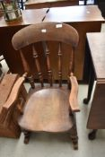 A traditional stained frame farmhouse rocking chair of small proportions