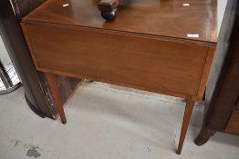 An early 20th Century Regency revival bleached mahogany pembroke table