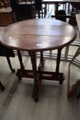 A Victorian oak occasional table in the Gothic style having circular top, diameter approx. 67cm