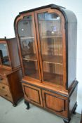 An early 20th Century low countries style hardwood and ebonised display cabinet having double