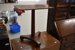 A William IV occasional table having rosewood base and column, possibly later mahogany top, width