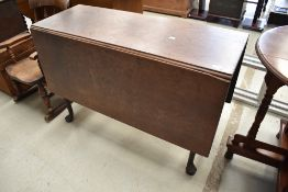 A mahogany gateleg table in the Queen Anne style