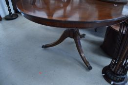 A reproduction Regency circular dining table, with inlay detailing to splay legs, diameter approx.
