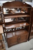 A 19th Century oak waterfall style bookcase with double cupboard under, approx height 142cm, width