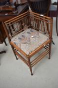 A 19th Century simulate bamboo having later William Morris style upholstered seat