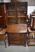 An early to mid 20th Century oak and ply bureau bookcase