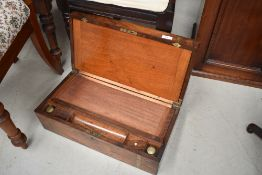A 19th Century mahogany and brass banded lap desk
