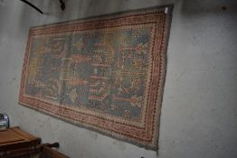 A traditional Persian style rug , edged with branded strip, R W Weekes Ltd, Tunbridge Wells, approx.