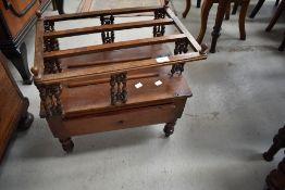 A 19th Century mahogany canterbury having bobbin spindle frame (top frame loose)