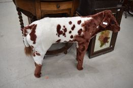 A modern decorative plush 'cow' height approx. 70cm