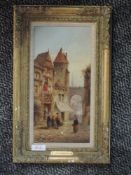 An oil painting on board, F A Rezia, Continental townscape, signed and dated 1905, 30 x 15cm, plus