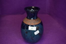An arts and crafts style studio pottery vase by Vallauris France signed to base with two tone blue