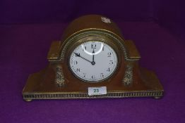 A brass cased late Victorian mantle clock having enamel face dial marked Made In France