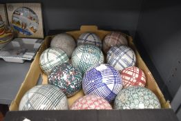 A selection of twelve Scottish pottery carpet bowls in various designs