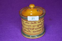A vintage Cornish ware style ceramic smokers tobacco jar with motto inscribed
