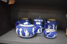 A ceramic tea set by Wedgwood in the Jasperware design in deep blue ground