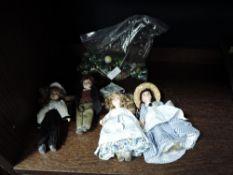 A bag of vintage marbles and four porcelain headed dolls