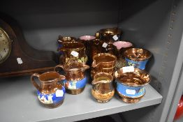 A selection of Victorian lustre ware milk cream and water jugs including hand decorated designs