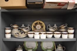 An antique coffee and tea service having cobolt blue and gilt detailing and similar matching Ridgway