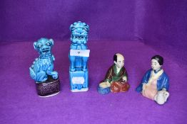 Two blue glazed Chinese temple dogs of Fo and a near pair of Japanese nodding head figures
