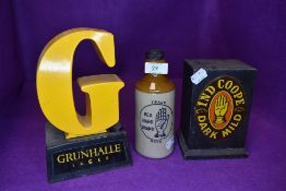 Two pub tavern bar advertising tap lights for Ind Cooper and Grunhalle lager also similar stone ware