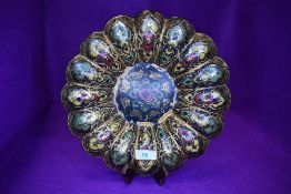 A papier mache an lacquer work plaque in the form of a lotus of similar flower