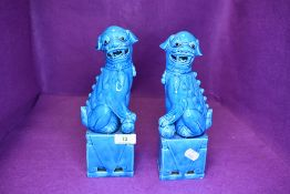 A pair of Chinese export temple dogs of Fo having blue glaze both 25cm tall approx