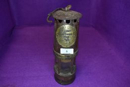 A genuine miners lamp having steel and brass case by Hailwood and Ackroyd model and number worn