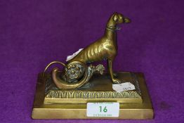 A Victorian desk top figure of a Grey Hound or similar racing dog brass cast
