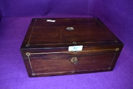 A late Victorian sewing case with rose wood body inlayed with brass and mother of pearl some