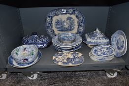 A selection of various blue and white wear ceramics including meat charger, drainer and tureen etc