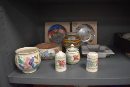 A selection of mid century and later hand decorated Poole pottery including condiments and boxed