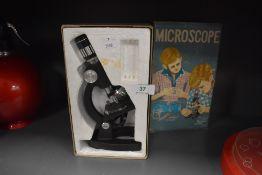 A vintage childs scientific microscope in case no. 207-Z