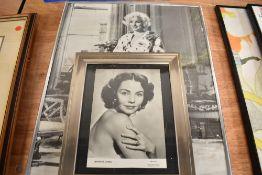 A photographic print of Marilyn Monroe and Jennifer Jones