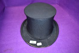 A late Victorian collapsible or fold away top hat retailed by Harrods London Easy Fitting some