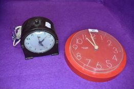 Two clocks including bakelite Smiths alarm clock and Westclox red cased